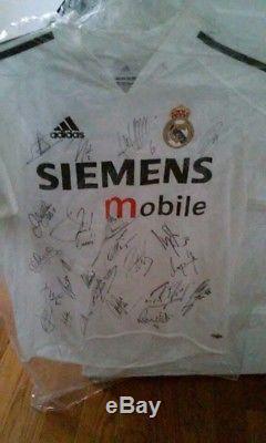 2005 Autographed Real Madrid Jersey. Signed by David Beckham, Ronaldo, Figo